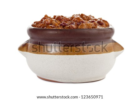 Chili con Carne served in a clay pot over a white background - stock photo