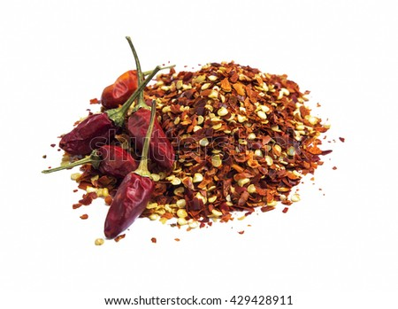 Chili flakes and peppers heap isolated on white - stock photo