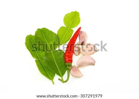 Chili ,garlic,  and kaffir lime leaves, herb and spicy ingredients for making Thai food - stock photo