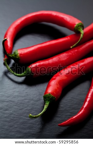 chili peppers on dark textured background - stock photo