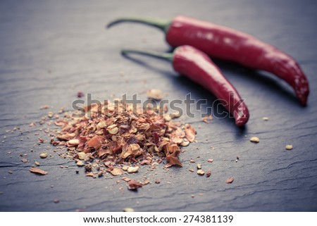 Chili peppers on rustic background( fresh, chopped and dried)  - stock photo