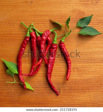 chili peppers on wooden background - stock photo