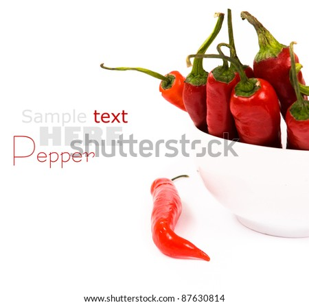 chili peppers over white - stock photo