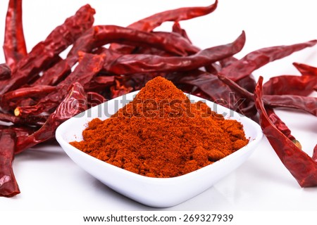 chili powder and dried chili on a white background. image suitable for food products, restaurants, fresh goods store, wholesaler and seller of the product chilies or chili based health products - stock photo