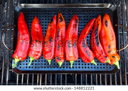 Chilies getting ready to be grilled on the grill  - stock photo