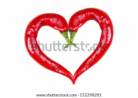 chilies in love shape on white background - stock photo