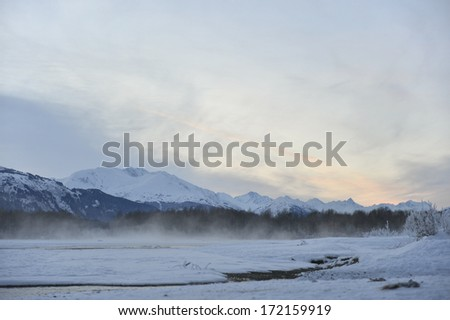Chilkat River and Snowcovered Mountains. Chilkat State Park. Mud Bay. HAINES. Alaska. USA - stock photo
