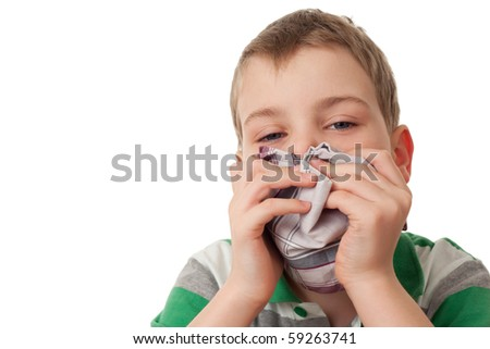 chilled boy wipes scarf nose isolated on white background - stock photo