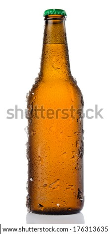 Chilled isolated brown beer bottle with drops and ice - stock photo