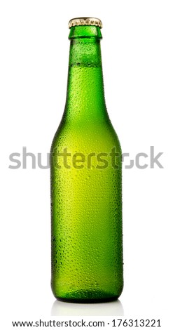 Chilled isolated green beer bottle with condensation drops - stock photo