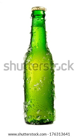 Chilled isolated green beer bottle with drops and ice - stock photo