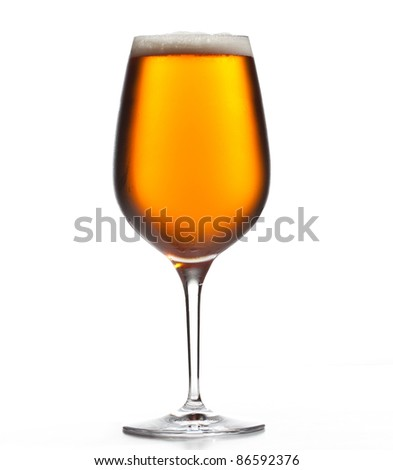 Chilled isolated wine goblet with small droplets of condensation on the outside of the glass and filled with golden colored beer - stock photo