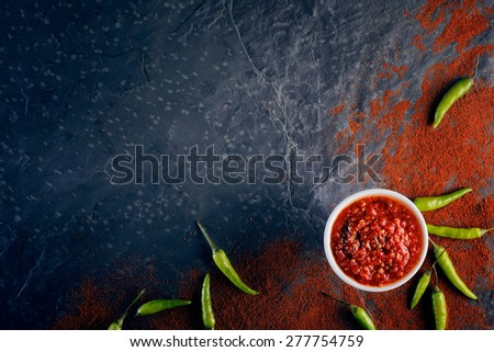 Chilli and garlic relish on black slate background from above - stock photo