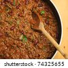 Chilli con carne being stirred with wooden spoon. - stock photo