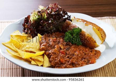 Chilli con carne with potato - stock photo