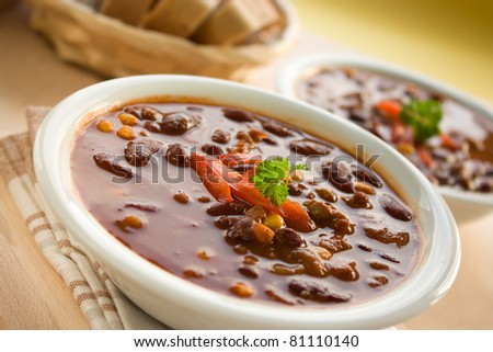 Chilli con carne with red pepper and parsley - stock photo