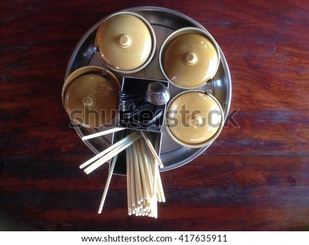 chilli,Garnish for noodles In ceramic cup on a brown wooden table. Flavoring - stock photo
