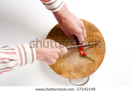 Chilli pepper and Knife on wooden bamboo chopping board