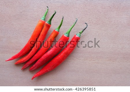 chilli pepper on wooden - stock photo