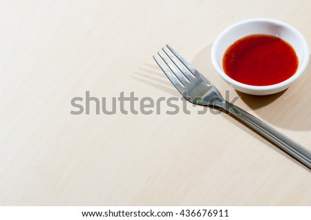 Chilli sauce with fork - stock photo