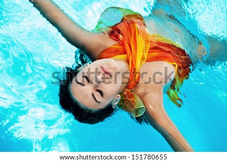 Chilling girl in the swimming pool, outdoor shoot - stock photo