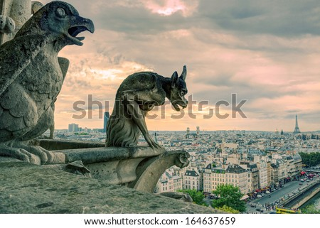 Chimeras (gargoyle) of the Cathedral of Notre Dame de Paris overlooking Paris, France - stock photo