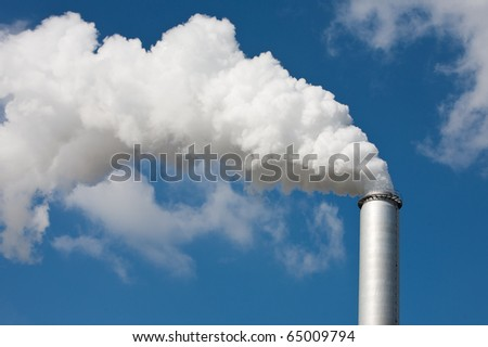 chimney in an industrial area - stock photo