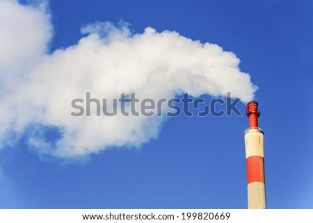 chimney of an industrial company with smoke. symbolic photo for environmental protection and ozone. - stock photo