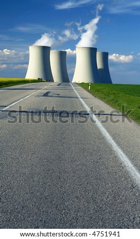 Chimney of power station on  horizon with road - stock photo