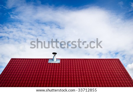 Chimney on tile roof - stock photo