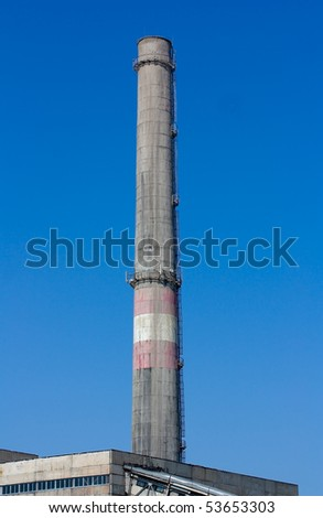 Chimney pipe against the blue sky - stock photo