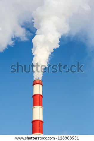 chimney power plant against the blue sky