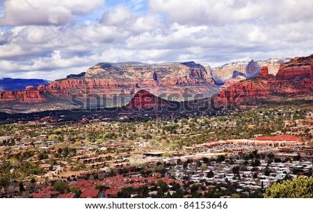 Chimney Rock Bear Mountain Orange Red Rock Canyon Houses, Shopping Malls, Blue Cloudy Sky Green Trees Snow West Sedona Arizona - stock photo