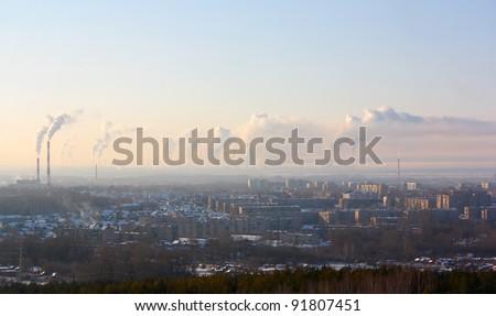 Chimney-stalks pollute atmosphere. Smoke on the city. - stock photo
