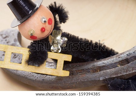 Chimney sweep with horseshoe / Good Luck - stock photo