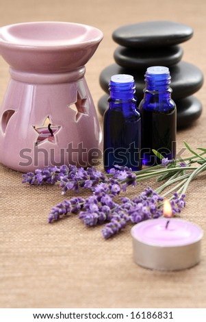 chimney with candle and bunch of lavender - stock photo