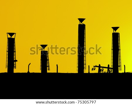 Chimneys from a factory, different sizes - stock photo
