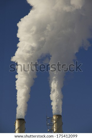 Chimneys on blue sky background.  - stock photo