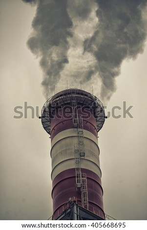 Chimneys with dramatic clouds of smoke - stock photo