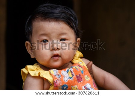 CHIN STATE, MYANMAR - JUNE 18 2015: Cute young baby girl in the recently opened for tourists Chin State Mountainous Region, Myanmar (Burma) - stock photo