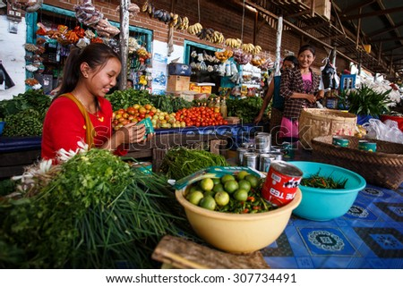 CHIN STATE, MYANMAR - JUNE 18 2015: Fresh fruit and veg market in the recently opened for tourists Chin State Mountainous Region, Myanmar (Burma) - stock photo