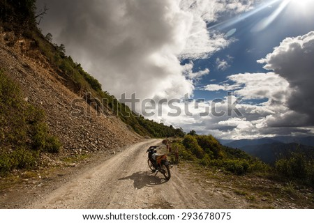 CHIN STATE, MYANMAR - JUNE 16 2015: Motorbike ready for the mountains in the recently opened to foreigners area of Chin State - western Myanmar (Burma) - stock photo