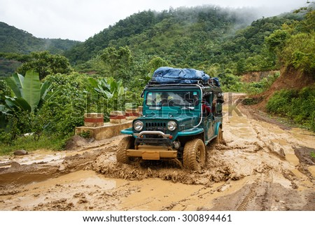 CHIN STATE, MYANMAR - JUNE 22 2015: Offroad Adventure on Dirt Road Leading Through Chin State Mountainous Region, Myanmar (Burma) - stock photo