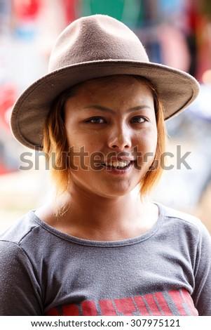 CHIN STATE, MYANMAR - JUNE 18 2015: Pretty lady in the Chin State Mountainous Region, Myanmar (Burma) - stock photo
