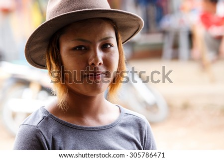 CHIN STATE, MYANMAR - JUNE 18, 2015: Pretty lady in the recently opened for tourists Chin State Mountainous Region, Myanmar (Burma) - stock photo