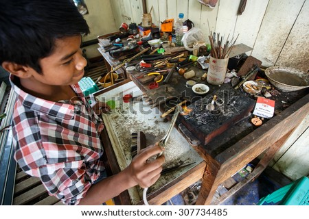 CHIN STATE, MYANMAR - JUNE 18 2015: Skilled metal work in the recently opened for tourists Chin State Mountainous Region, Myanmar (Burma) - stock photo