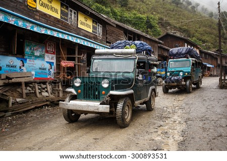 CHIN STATE, MYANMAR - JUNE 23 2015: Trucks in village popular for selling apples in the recently opened to foreigners area of Chin State - western Myanmar (Burma) - stock photo