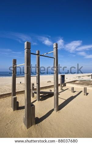 Chin Up Bars at Beach - stock photo