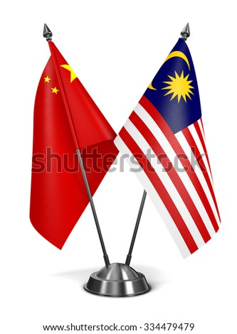 China and Malaysia - Miniature Flags Isolated on White Background. - stock photo