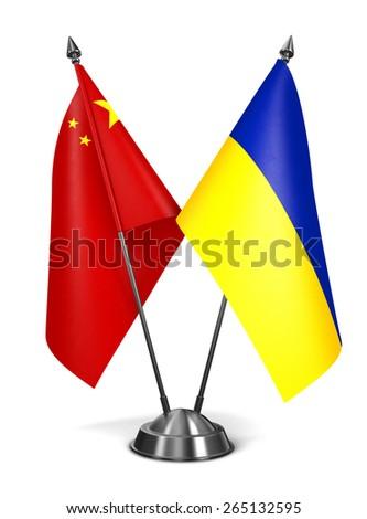 China and Ukraine - Miniature Flags Isolated on White Background. - stock photo